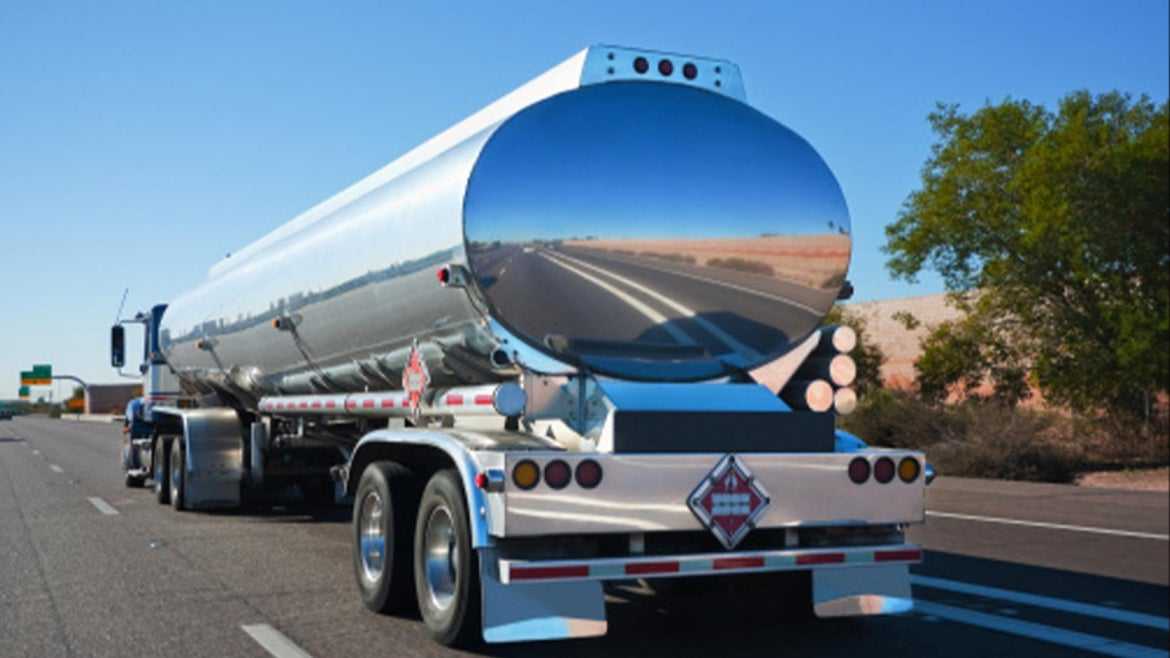 A photo of a tanker truck on the road.