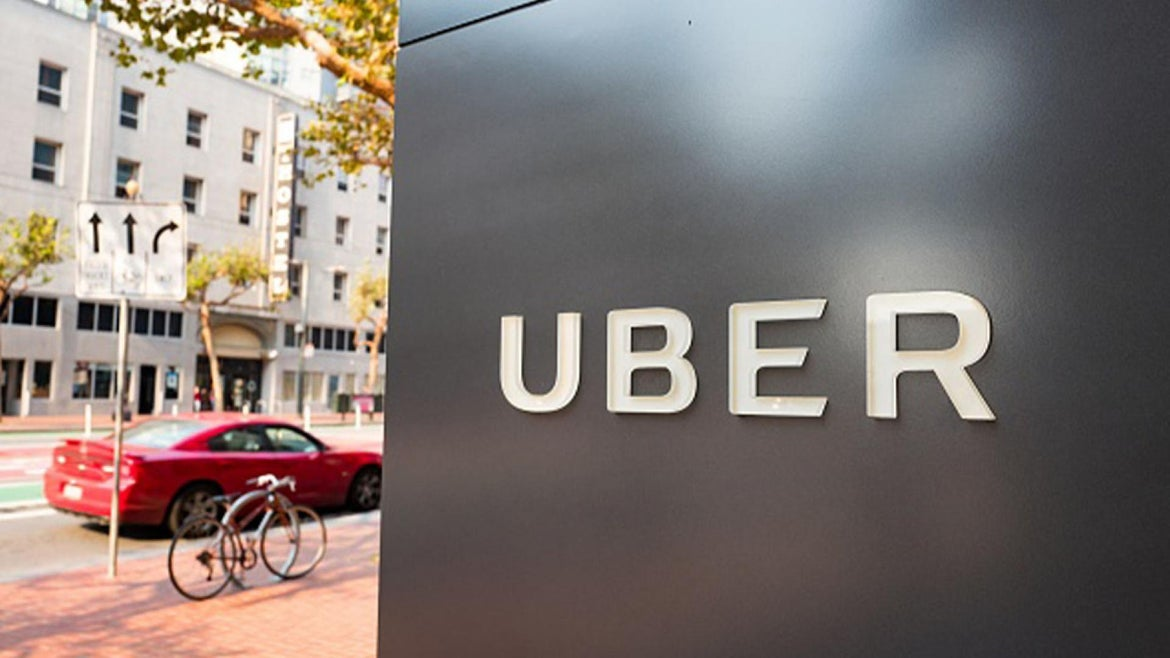 Sign with logo at the headquarters of car-sharing technology company Uber in the South of Market (SoMa) neighborhood of San Francisco, California,