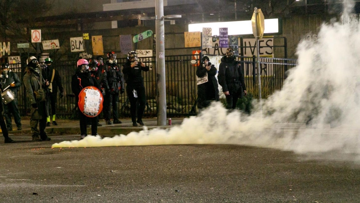 Tear gas envelops demonstrators at ICE headquarters during a protest against ICE (Immigration and Customs Enforcement) in Portland, Oregon, United States on January 23, 2021.