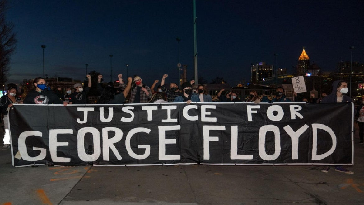 Demonstrators during trial of police officer charged with killing George Floyd.