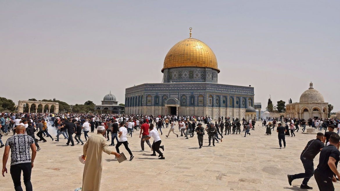 Israeli security forces and Palestinian Muslim worshippers clash in Jerusalem's al-Aqsa mosque compound, the third holiest site of Islam, on May 21, 2021.