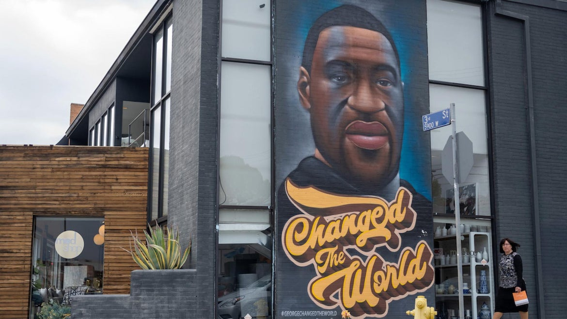 """A mural of George Floyd that reads, """"changed the world"""" amid the coronavirus pandemic on April 21, 2021 in Los Angeles, California."""