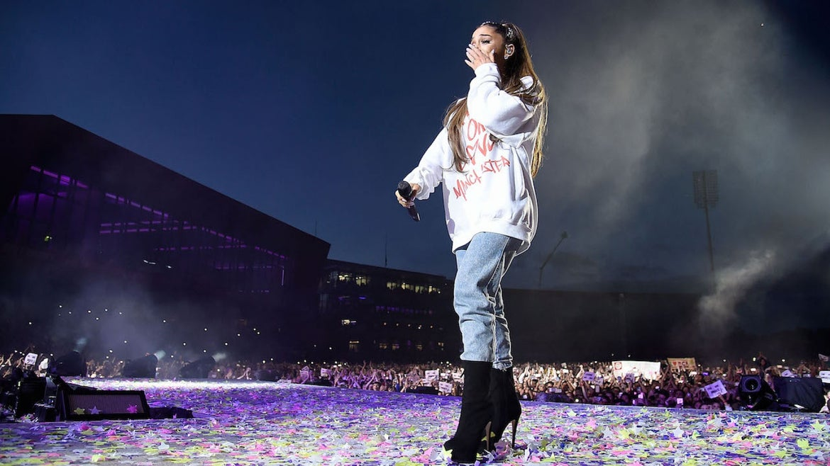 Ariana Grande wipes away a tear as she performs on stage during the One Love Manchester Benefit Concert at Old Trafford Cricket Ground on June 4, 2017 in Manchester, England