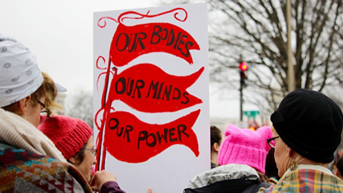A stock image of protestors marching in protest of anti-abortion laws.