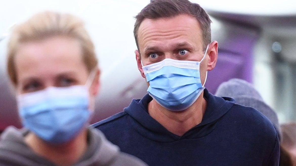 President Vladimir Putin's most vocal critic Alexei Navalny and his wife Yulia are seen disembarking a plane back to Russia in January 2021, six months after Navalny was poisoned.