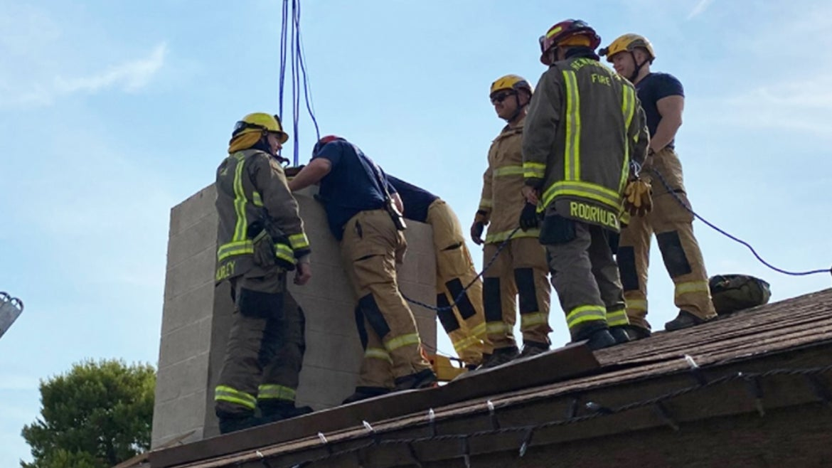 Firefighters used a rope system in order to rescue the 18-year-old who accidentally got stuck in her chimney.