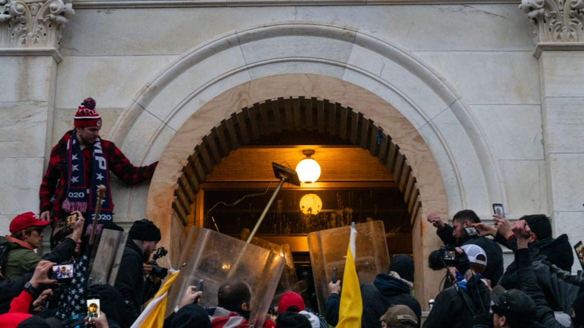 Demonstrators attack law enforcement with furniture in an attempt to enter the U.S. Capitol building during a protest in Washington, D.C., U.S., on Wednesday, Jan. 6, 2021.