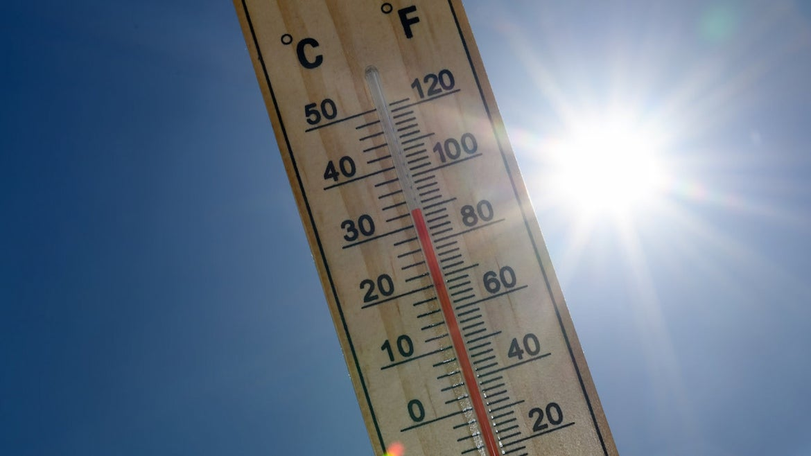 An alcohol thermometer is seen with the temperature 32 degrees Celsius or 90 degrees Fahrenheit in front of the radiant sun on May 29, 2020