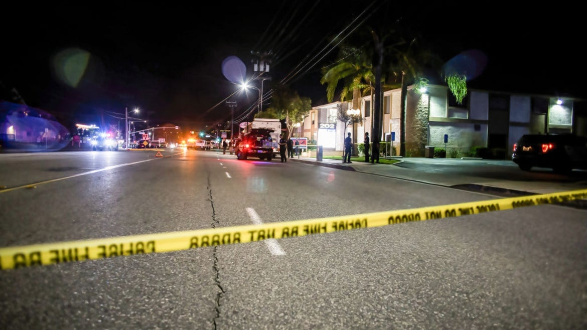 Police tape in front of a city scene