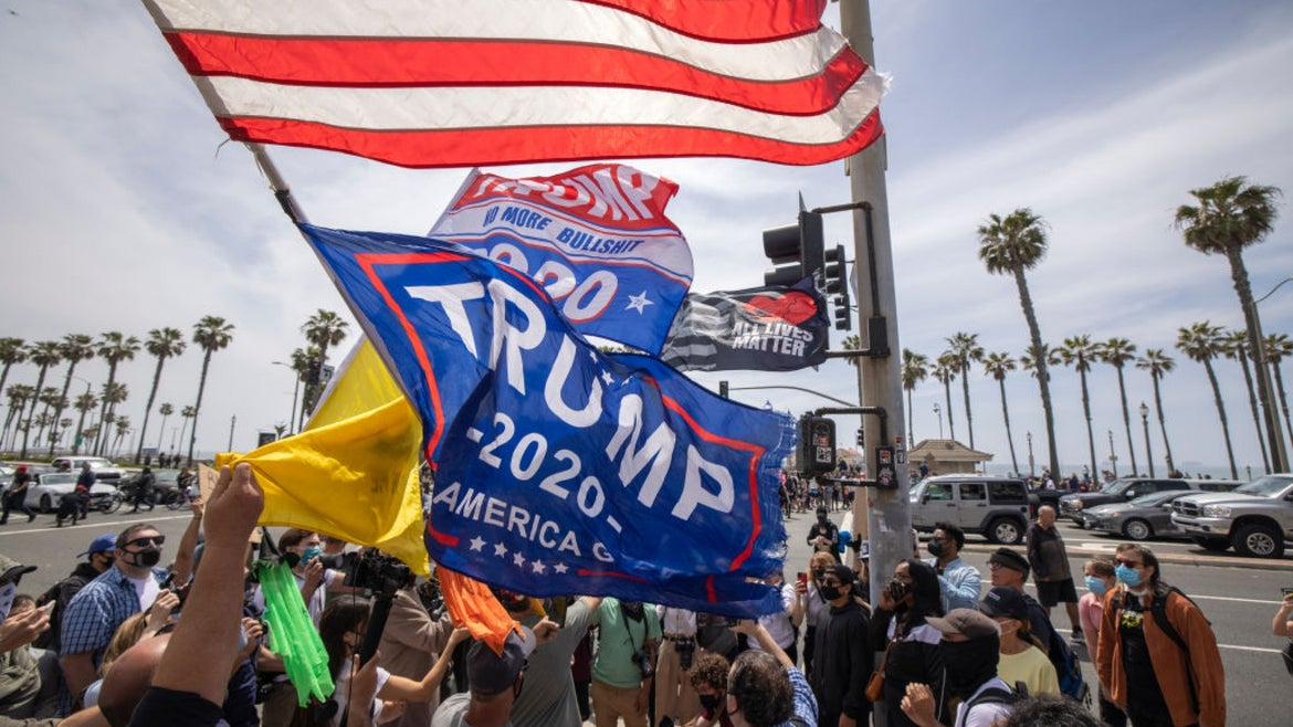 Group gathered for white lives matter rally with trump 2020 flag