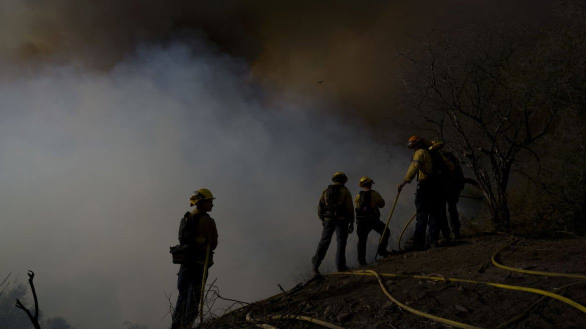 California wildfire smoke with firefighters on scene