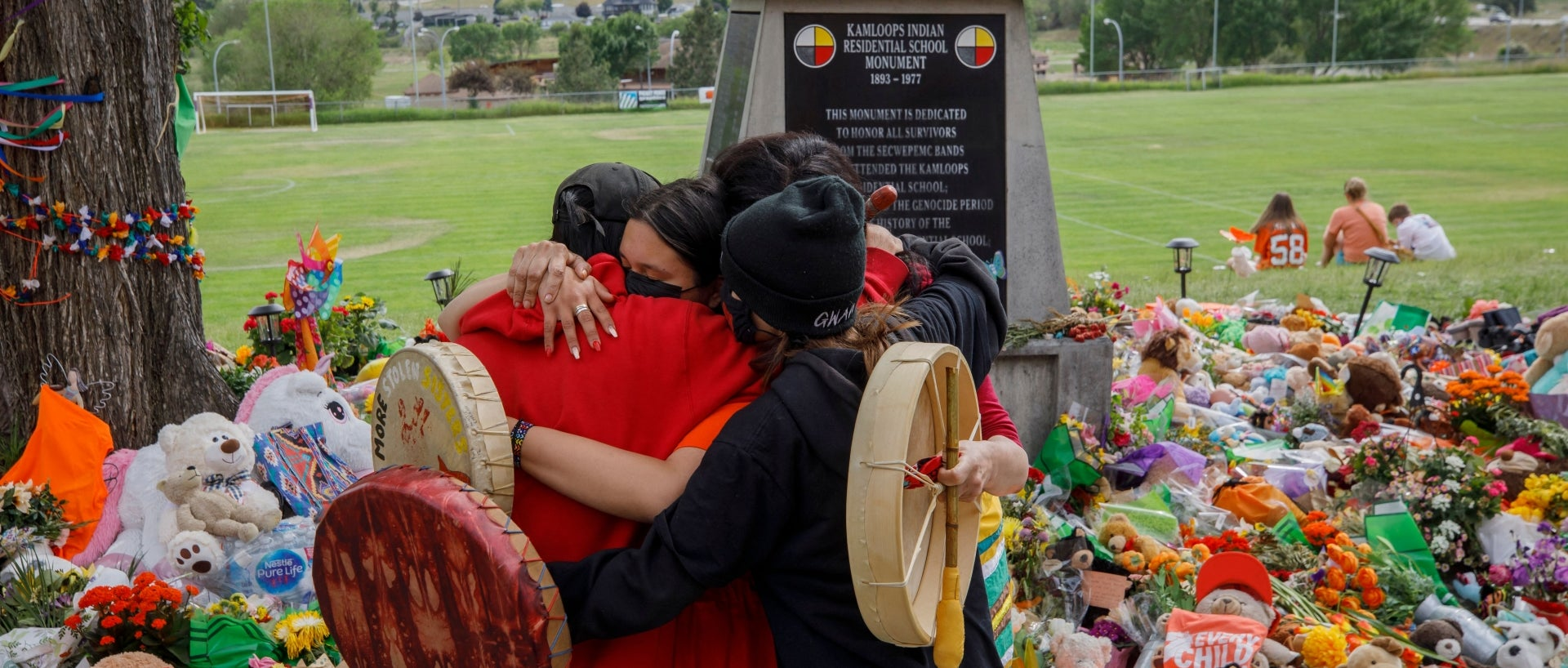 Tributes in front of the former Kamloops Residential School continue as the country grieves the 215 bodies of Indigenous children buried in a mass grave.