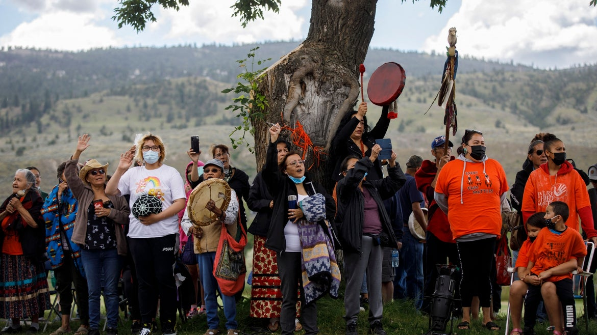 Crowds continue to gather in front of the former Kamloops Indian Residential School in support of the Tk'emlups te Secwepemc people after the remains of 215 children were discovered buried near the facility.