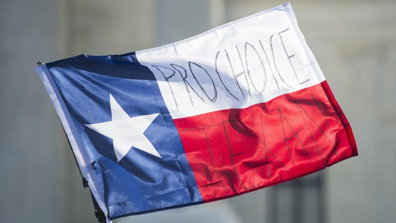 Pro-choice written on Texas flag