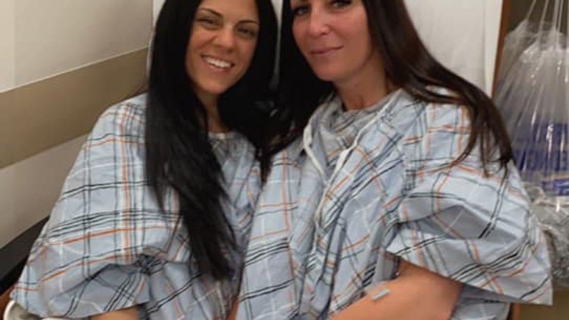 Lalima and Figueroa after surgery in hospital bed