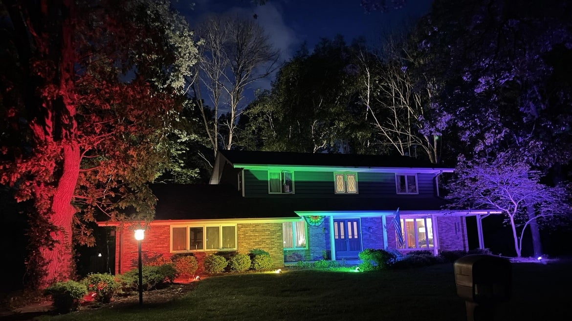 Fachino and Memo home lit by pride colored floodlights