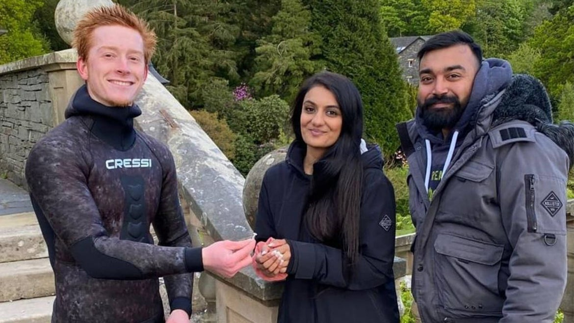 Diver Angus Hosking with Lake District Diving recovers the engagement ring of newly engaged couple  Rebecca Chaukria, 26, and her fiancé, Viki Patel, 25
