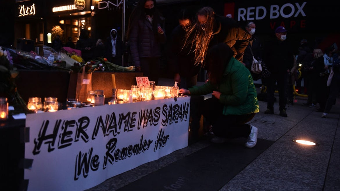 People light candles during a vigil for Sarah Everard on March 13, 2021 in Nottingham, England. Vigils are being held across the United Kingdom in memory of Sarah Everard. Yesterday, the Police confirmed that the remains of Ms Everard were found in a woodland area in Ashford, a week after she went missing as she walked home from visiting a friend in Clapham. Metropolitan Police Officer Wayne Couzens has been charged with her kidnap and murder.