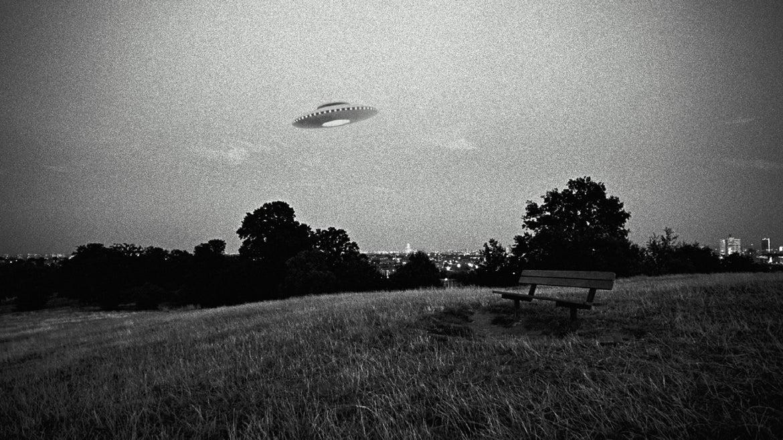 UFO in flight above park