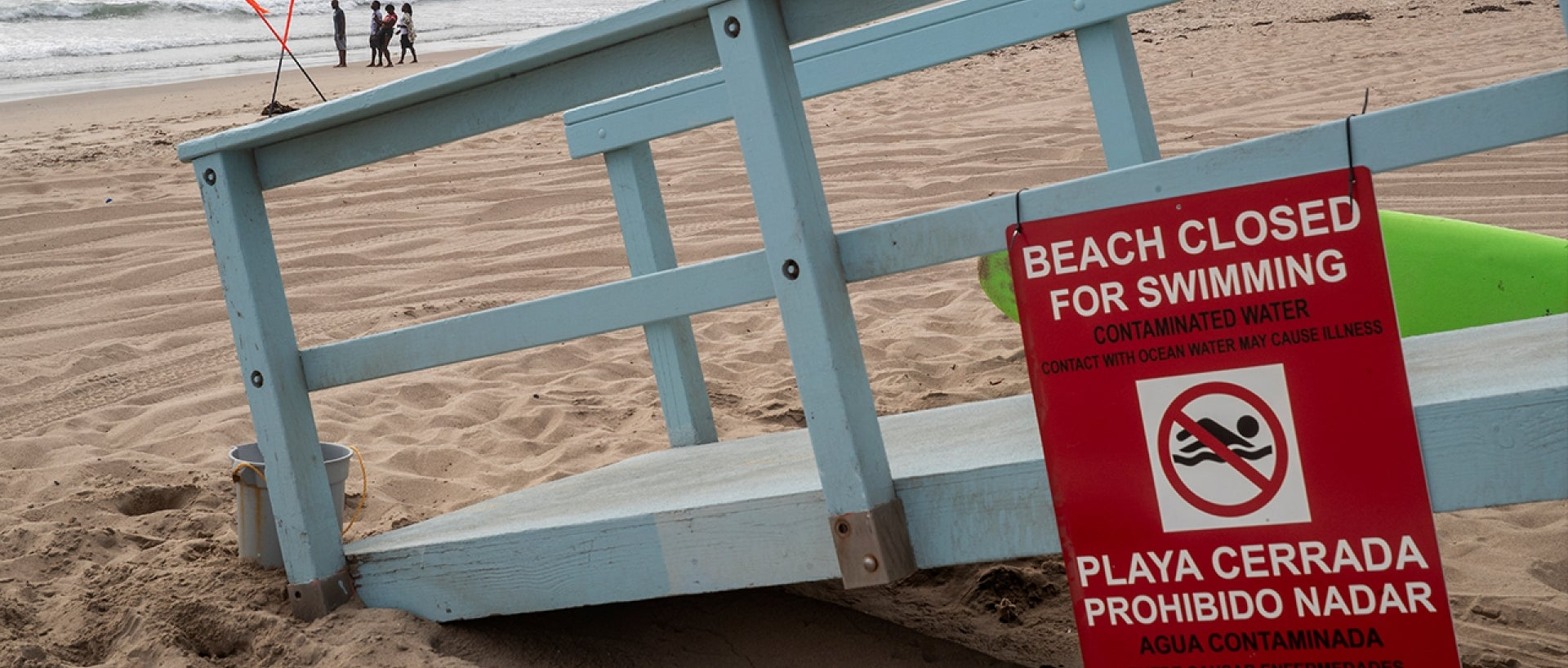 A sign at Dockweiler State Beach in Playa del Rey announces the beach is closed.