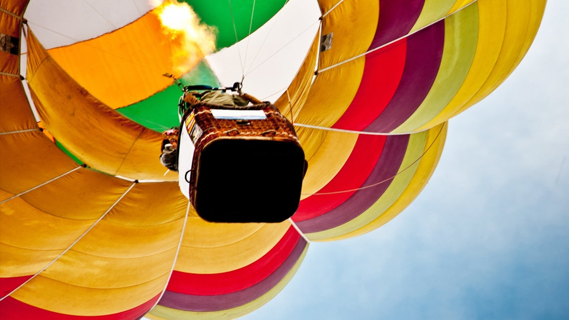 Brian Boland, 72, had become tangled in the equipment and fell to his death as the hot-air balloon ascended.