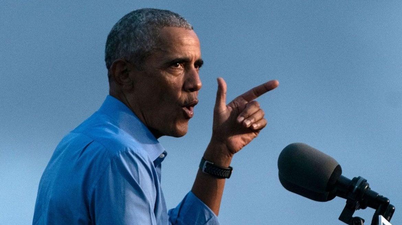 Former US President Barack Obama addresses Biden-Harris supporters during a drive-in rally in Philadelphia, Pennsylvania on October 21, 2020.