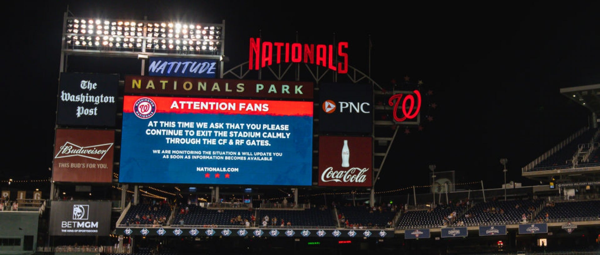 Digital sign in the Padres and Nationals' game that asks fans to exit slowly