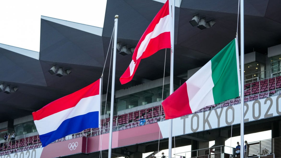 Varied country flags above Tokyo 2020 sign for Olympics