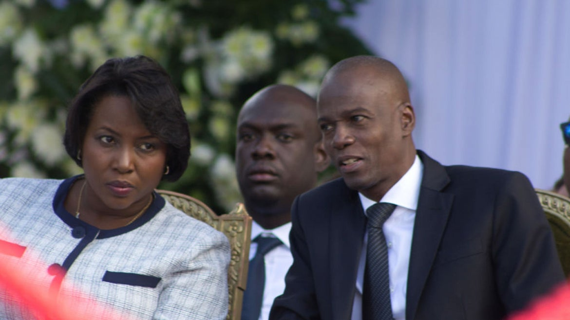 President of Haiti Jovenel Moise (C) and his wife attend a funeral service for the late former Haitian president Rene Preval.