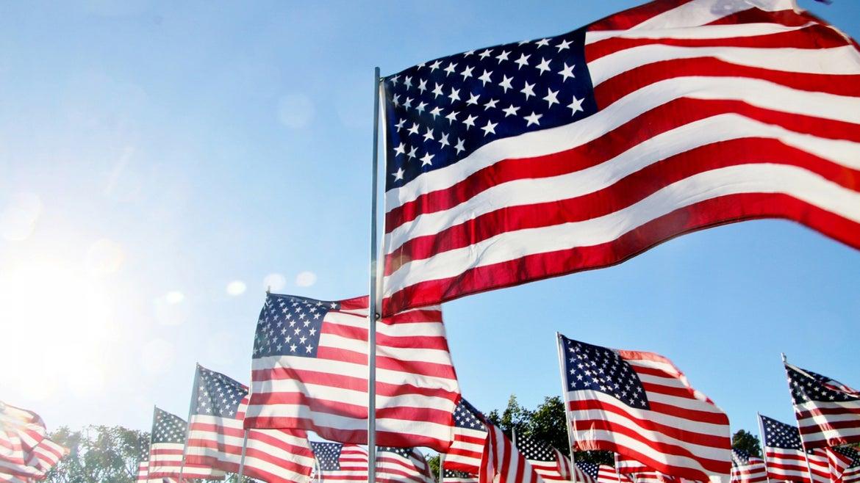 United States flags blow in the wind in Malibu, CA