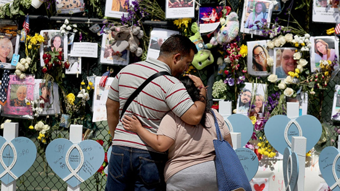 Recovery mission begins as mourners pray and weep at makeshift memorial.