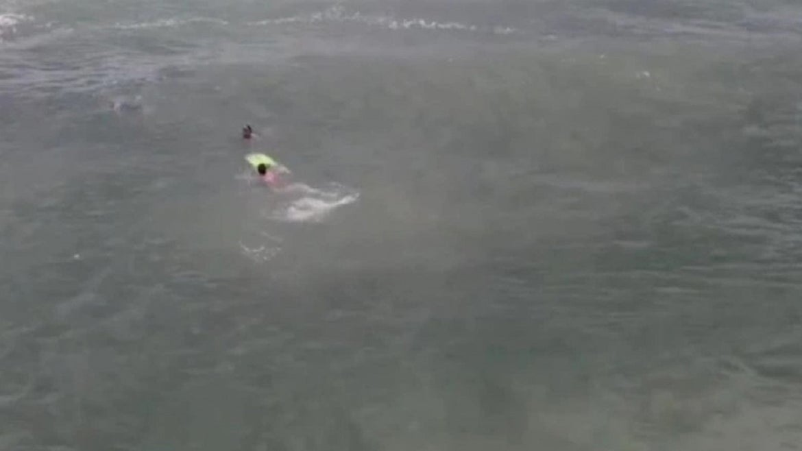 Drone video captures dramatic rescue.