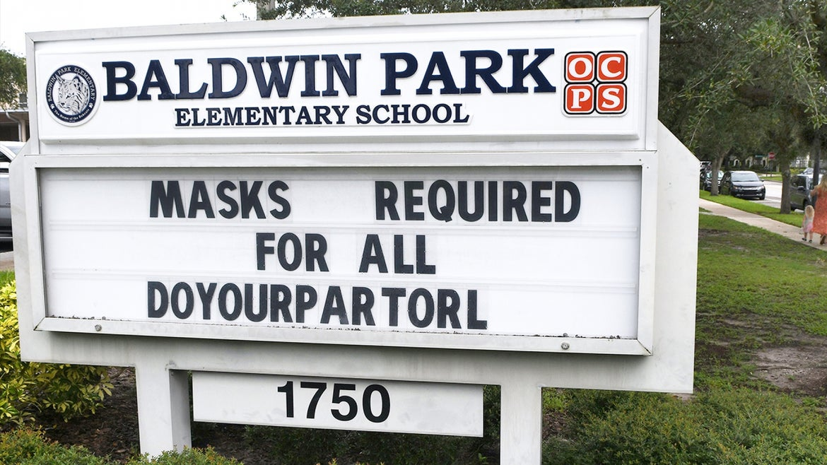 An Orlando school displays their mask requirement on their school's marquee.