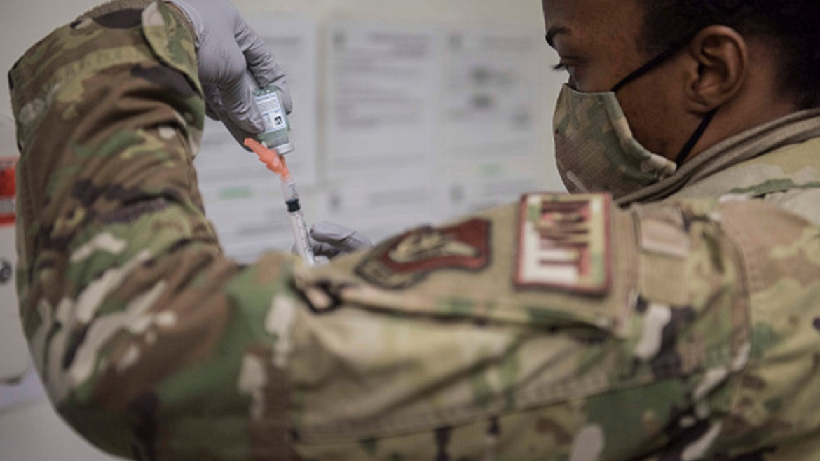 .S. Air Force Technical Sgt. Alexisa Humphrey prepares to administer the Moderna COVID-19 vaccine at Kunsan Air Base on December 29, 2020 in Kunsan, South Korea.