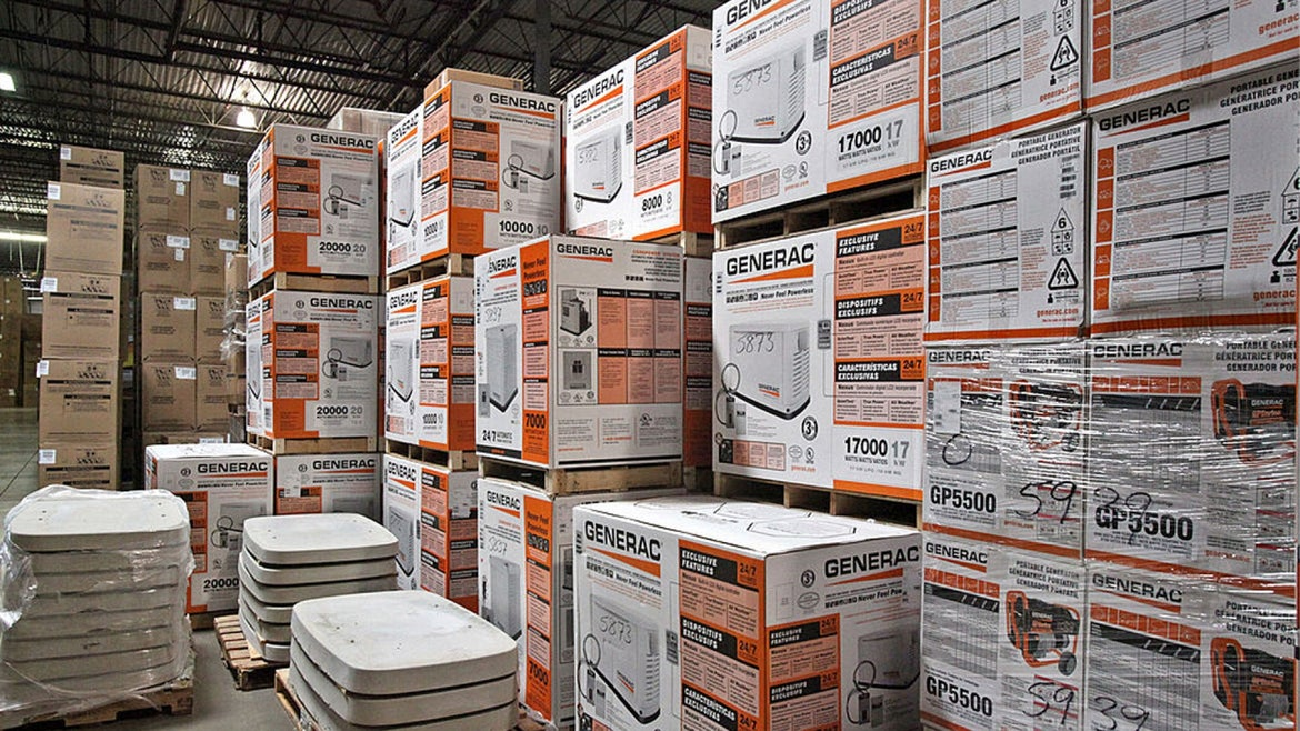 Generac Holdings Inc. generators sit stacked at the ABT Inc. warehouse in Glenview, Illinois, U.S., on Monday, Oct. 10, 2011.