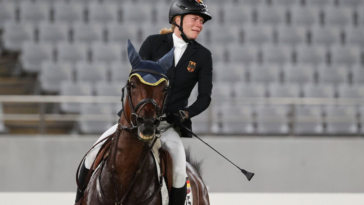 Germany's Annika Schleu competes in the women's individual riding show jumping event during the modern pentathlon competition at the 2020 Summer Olympic Games, at Tokyo Stadium