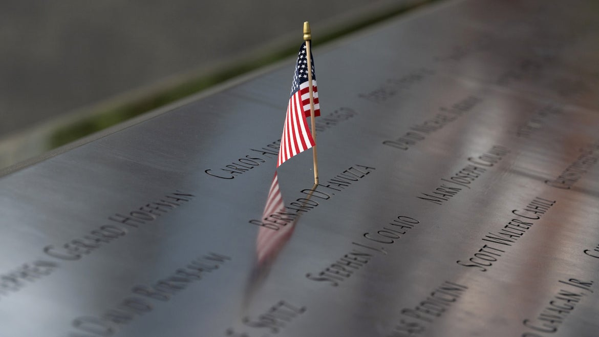 An American flag is seen in a person's name at the North reflecting pool at the 9/11 Memorial Plaza as the city continues Phase 4 of re-opening following restrictions imposed to slow the spread of coronavirus on August 10, 2020 in New York City.