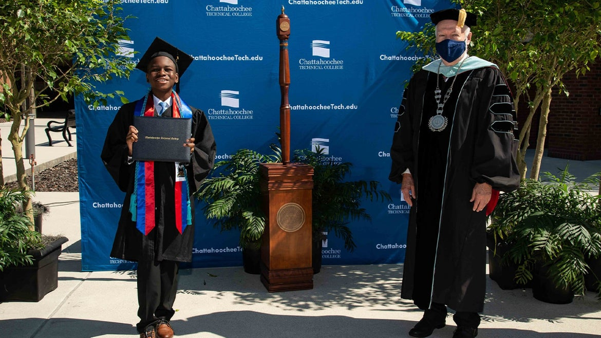 Anderson smiling after receiving degree from Chattahoochee Tech