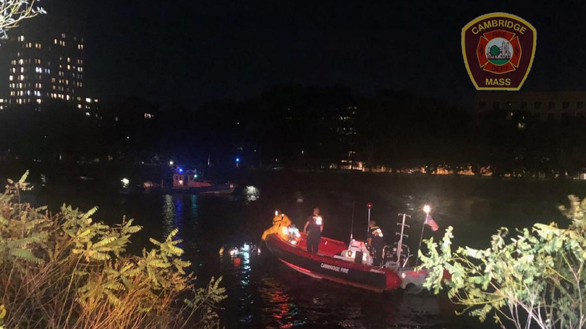 Cambridge Fire Department during rescue after car plunges in Charles River.