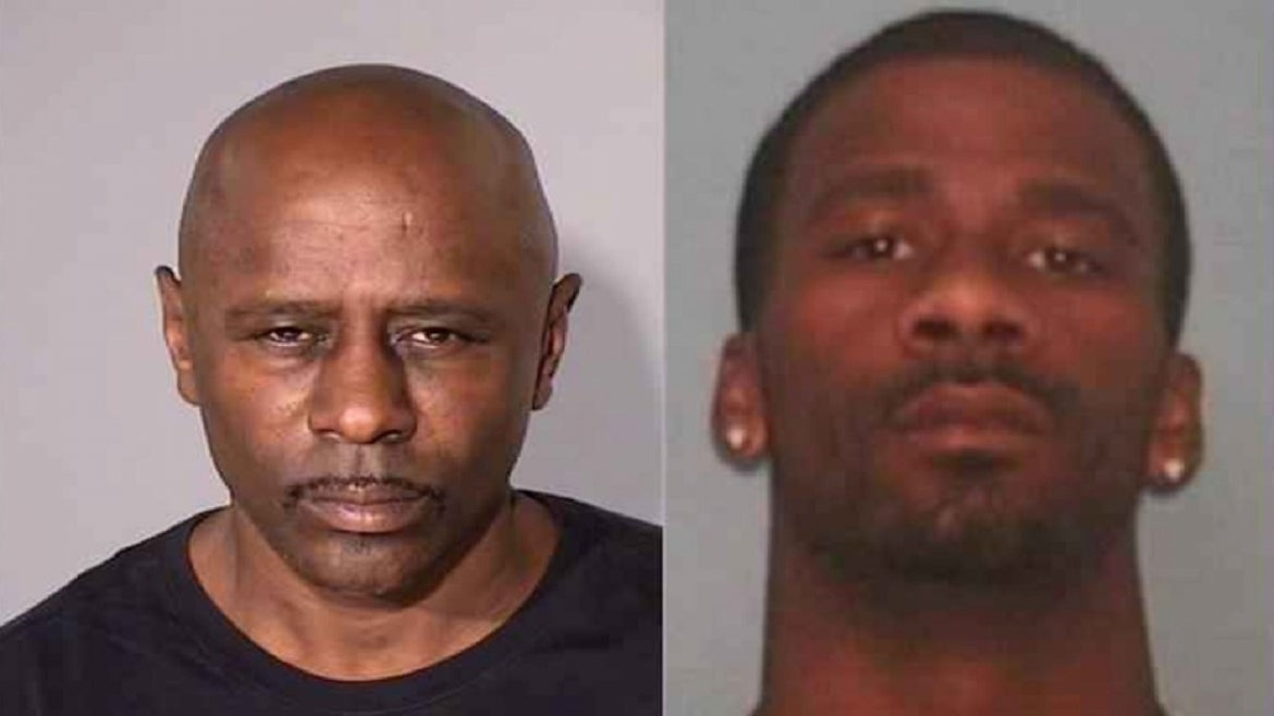 A father and son have been charged in connection with a quadruple homicide.