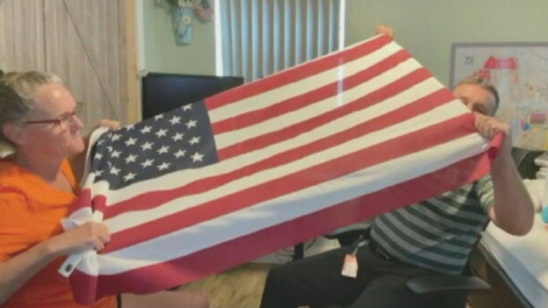fans unfurl flag