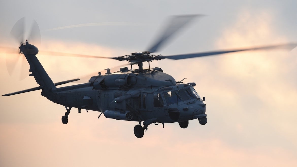 MH-60S Seahawk helicopter performing routine flight operation, Atlantic Ocean, July 4, 2018. Image courtesy Petty Officer 3rd Class Thomas Gooley / USS Harry S Truman.