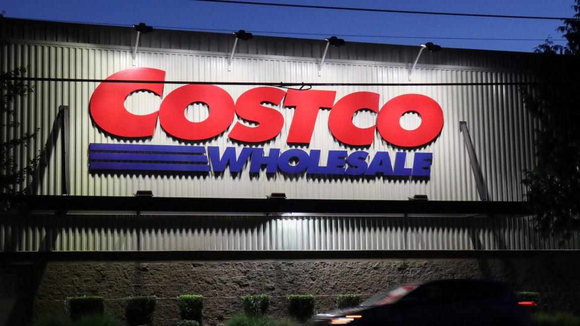 A car passes by a Costco store in Seattle. The American big box retailer is opening new locations in the United States and internationally.