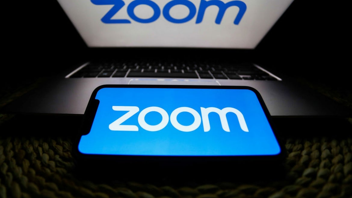 Zoom on laptop and phone
