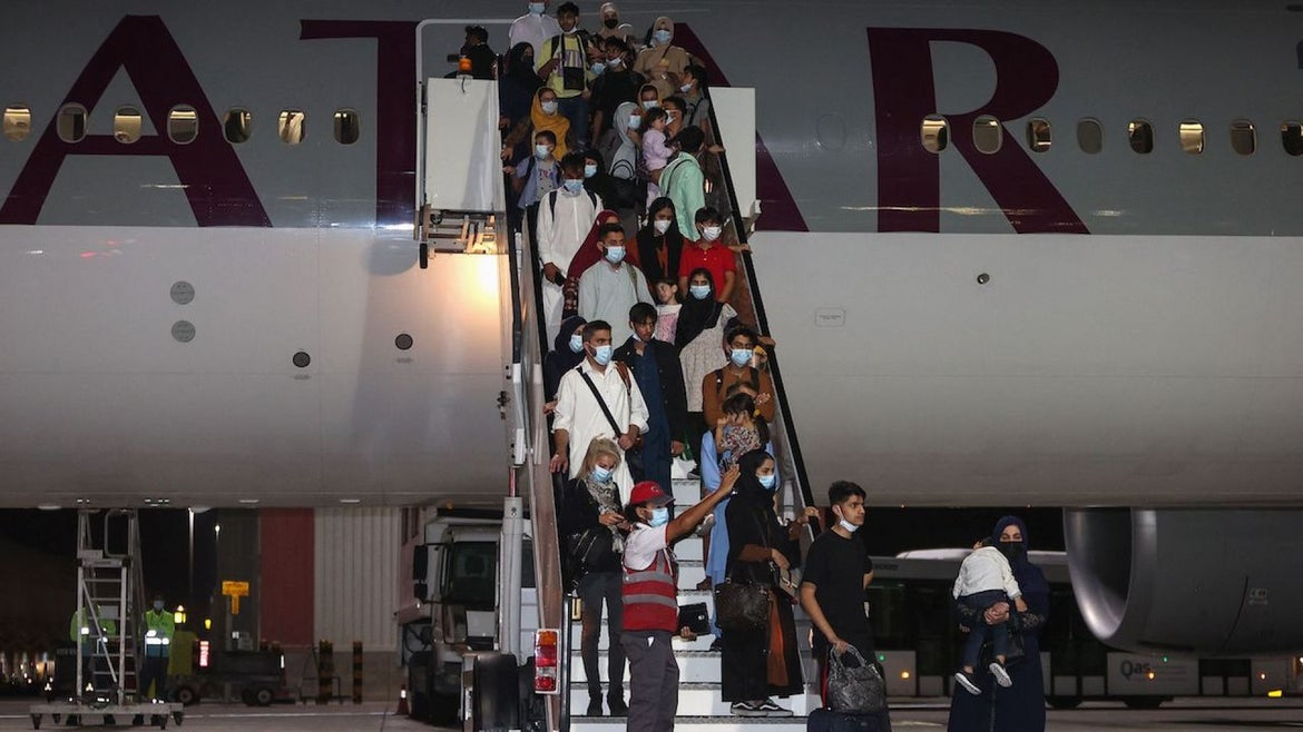 Evacuees from Afghanistan arrive at Hamad International Airport in Qatar's capital Doha on September 10, 2021.