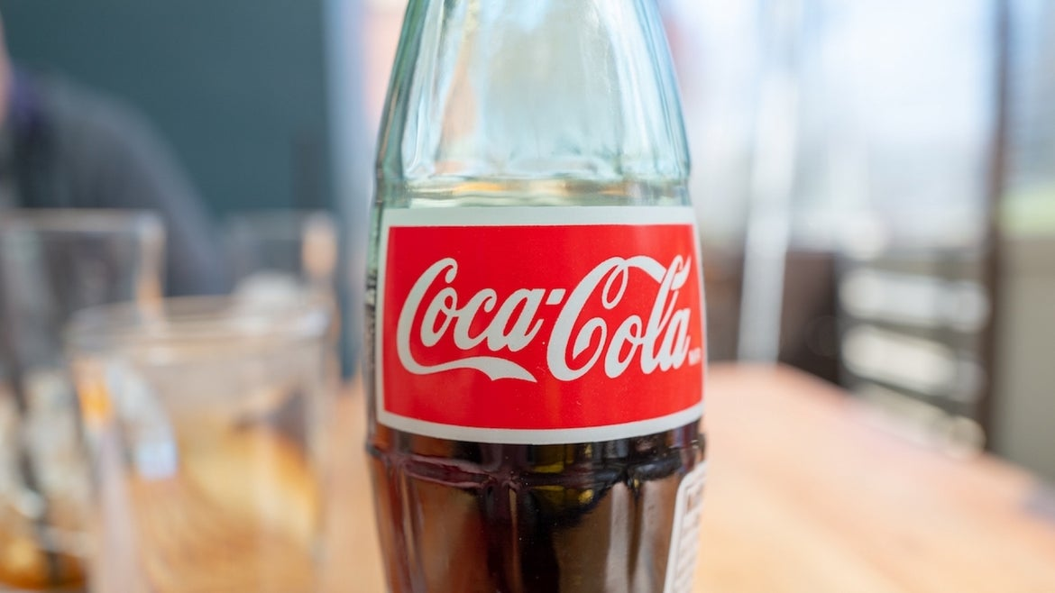 Close-up of logo for Coca Cola on glass bottle in a restaurant setting, Walnut Creek, California, March 4, 2021