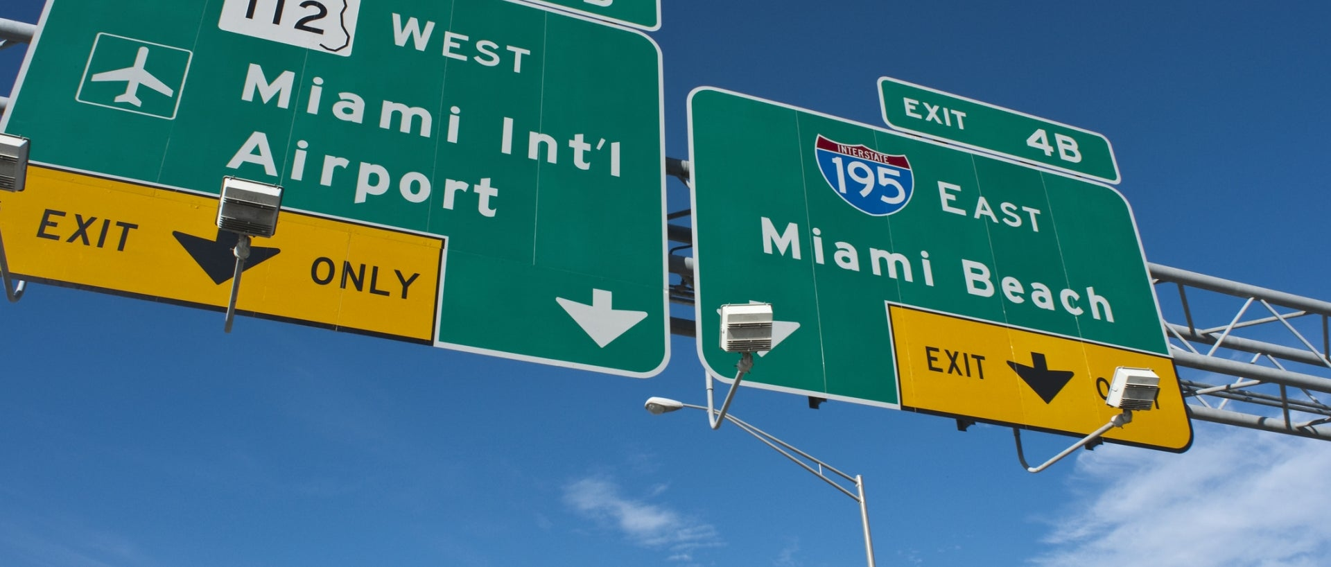 Sign showing Miami Intl Airport and Miami Beach