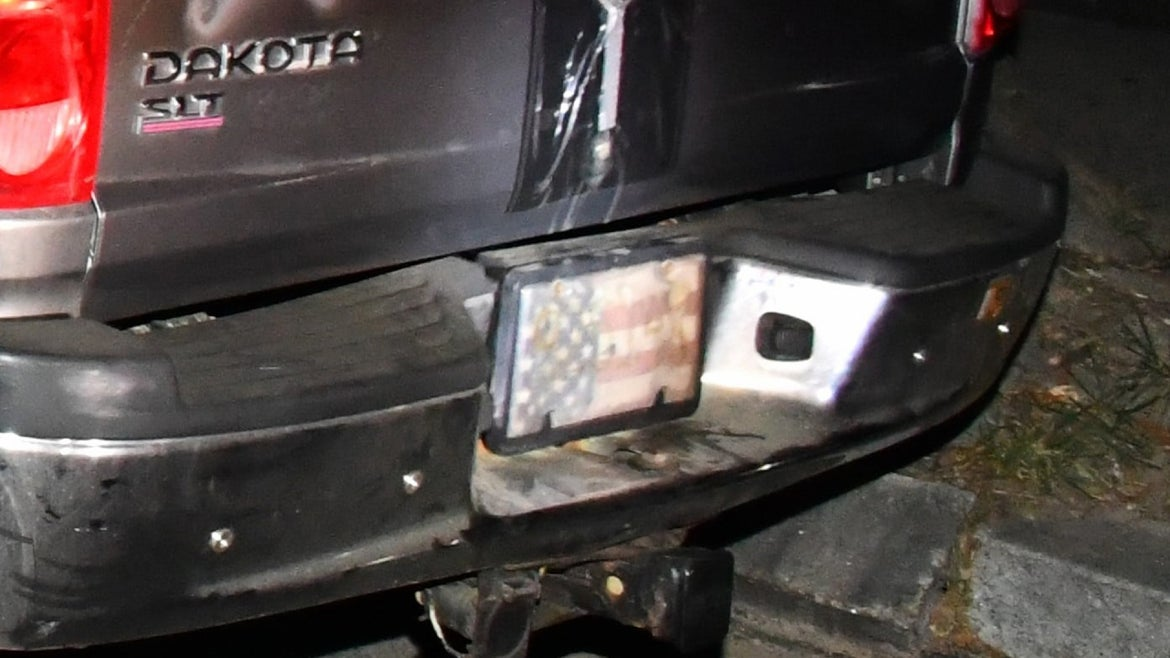 Truck of man arrested without license plate, American flag instead
