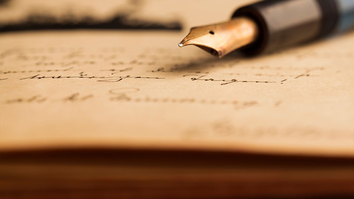 A stock image of a vintage letter and fountain pen.