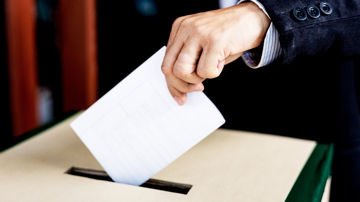 Two election workers were fired for allegedly destroying registration forms, officials said.